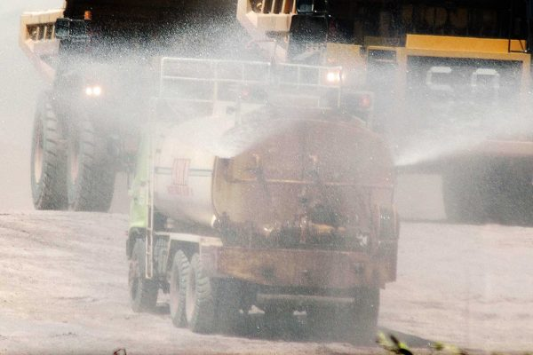 water truck spraying roads