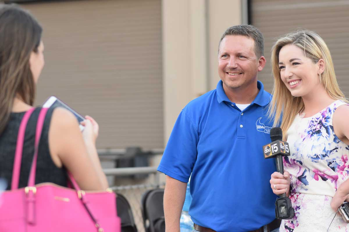 chris white with abc15 reporter for water drive