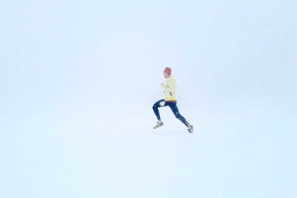 man running in the winter snow