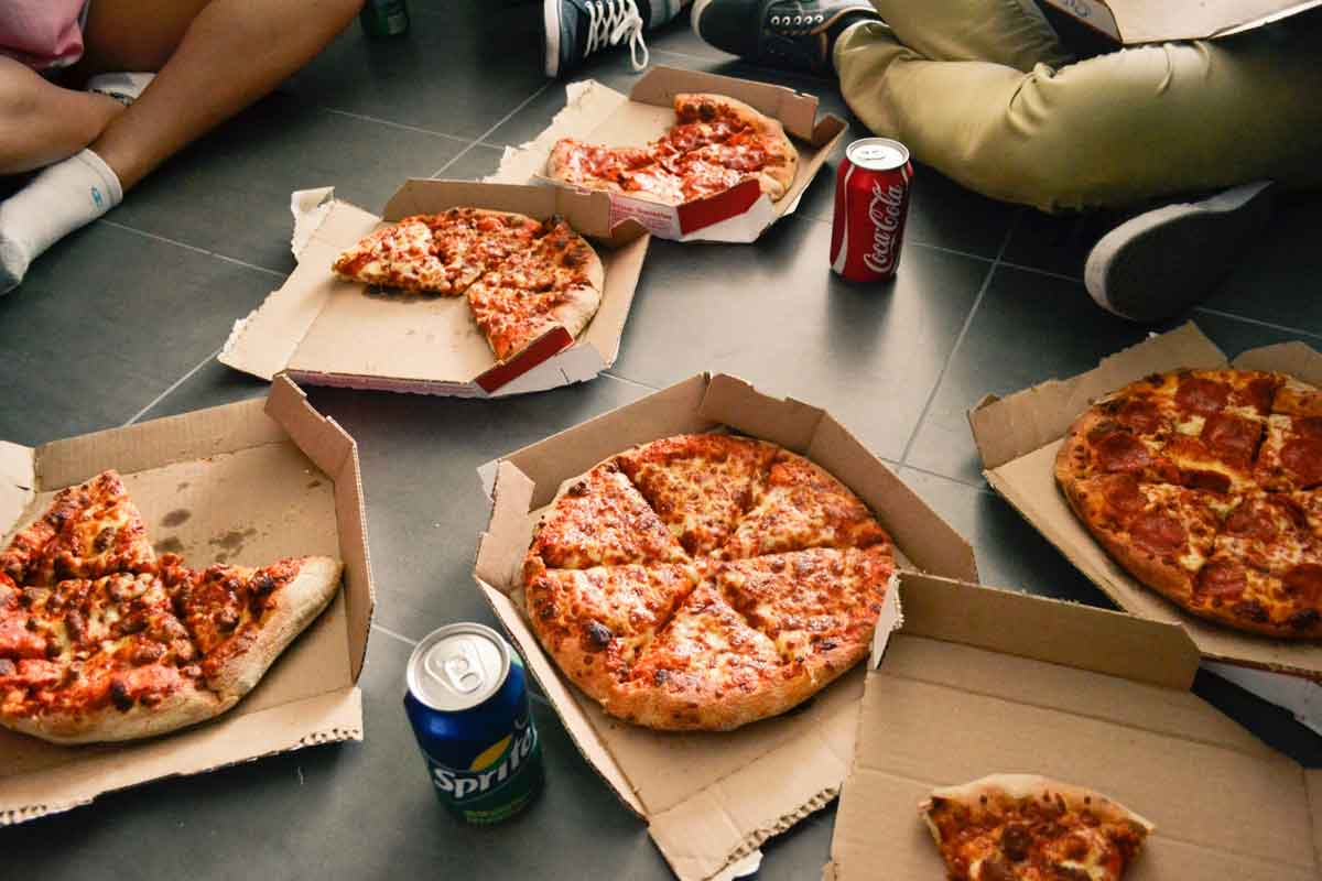 Pizza and soda on floor