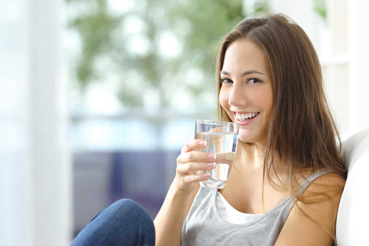 girl drinking clean water softener