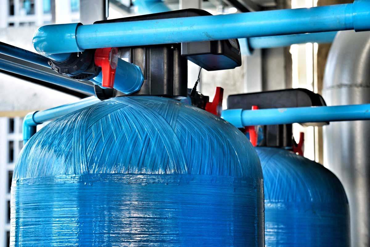 large blue water softening tanks