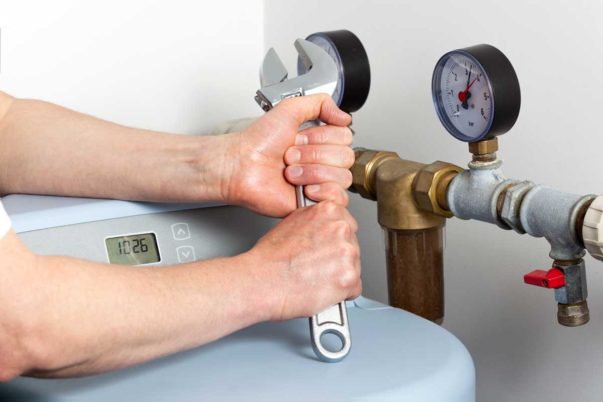 person fixing and doing maintenance on water softener