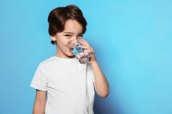 child drinking water and smiling