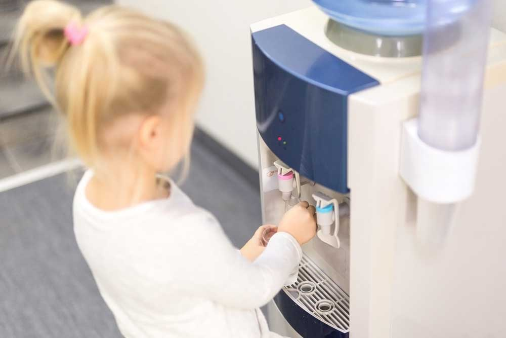 girl using the water cooler