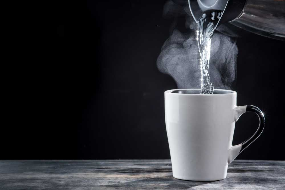 hot water pouring into cup