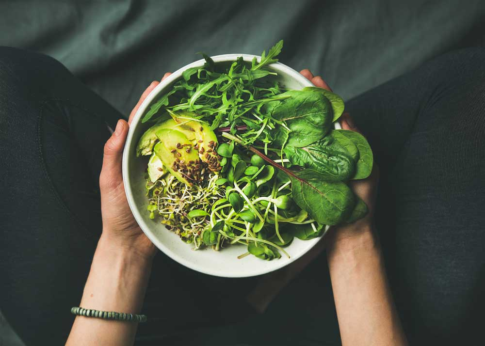 bowl of vegan food with lots of greens