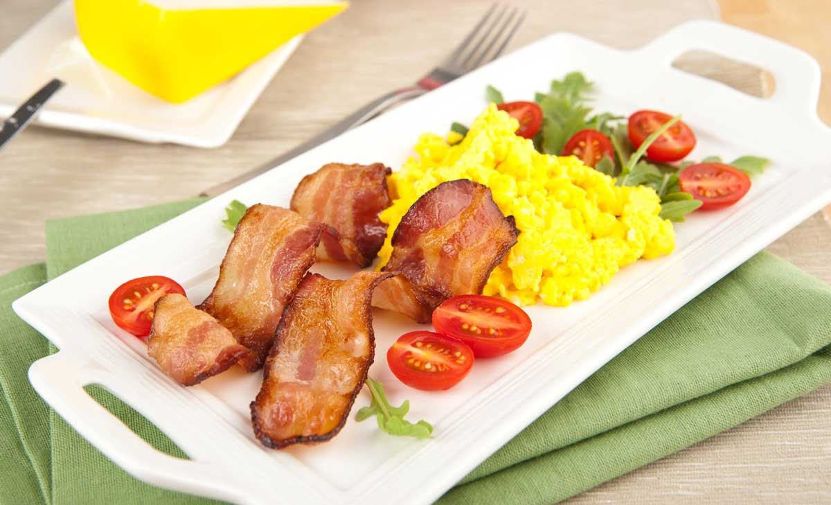 eggs and bacon on a plate in the morning